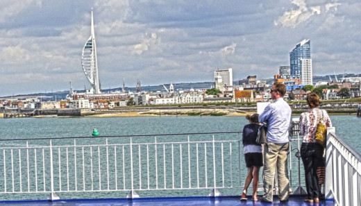 A family viewing the Spinnaker Tower at Portsmouth taken on the return ferry from the Isle of Wight.