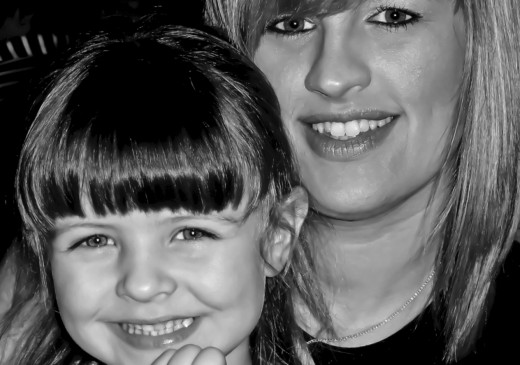 My stepdaughter and her daughter. I prefer Black and White for portraiture.