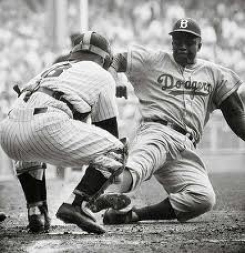 Jackie Robinson broke the racial barrier in sports. He was a great baseball player and he made people forget about the color of a Man's skin.