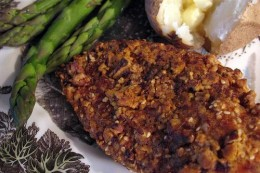 Pecan chicken is a quick and easy meal. Serve a fluffy baked potato and steamed asparagus with it for a delightful and delicious meal.