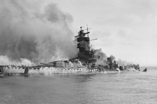 The Pocket Battleship Admiral Graf Spee sinks in flames after scuttling.
