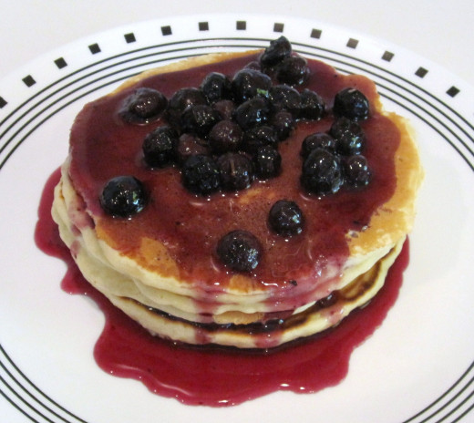 Basic pancakes topped with blueberry syrup, yum ^_^