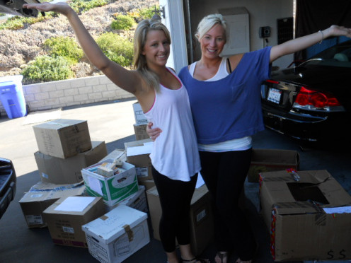 Hooray we did it! Chrissy and I standing before the books we collected for one underfunded elementary school.