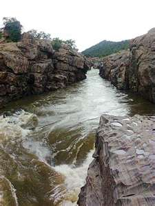 THIS STREAM OF WATER IS SO WIDE THAT GOATS JUMP FROM ONE SIDE TO THE OPPOSITE SIDE.