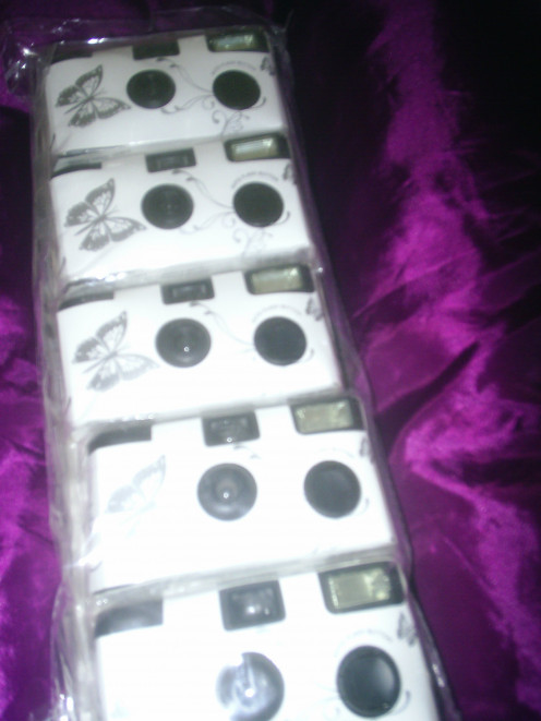 Put a disposable camera on each table for a quirky idea
