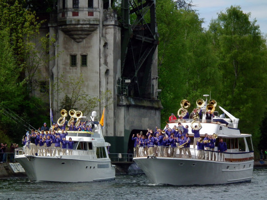 The University of Washington marching band performs on a boat during the opening day of the boating season.