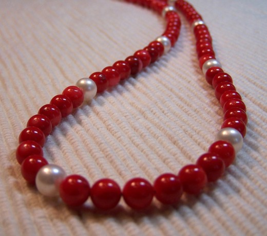 Elegant, refined and classic red coral and fresh water pearl necklace.