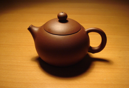 the purple clay teapot is the traditional ware for making tea.