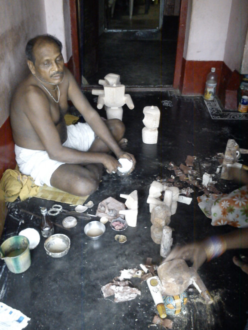 Local artist working on wooden sculptures of Lord Jagganath