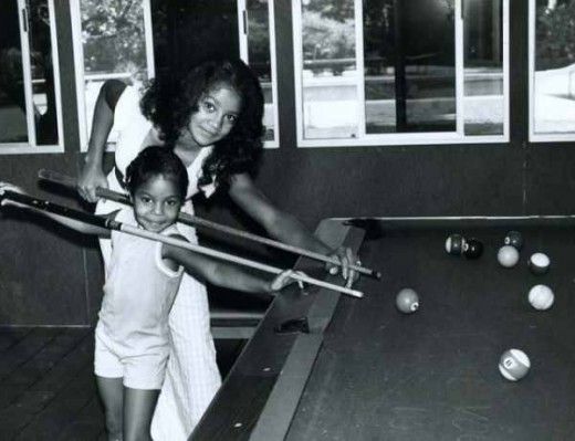 Young Latoya with baby sister Janet.