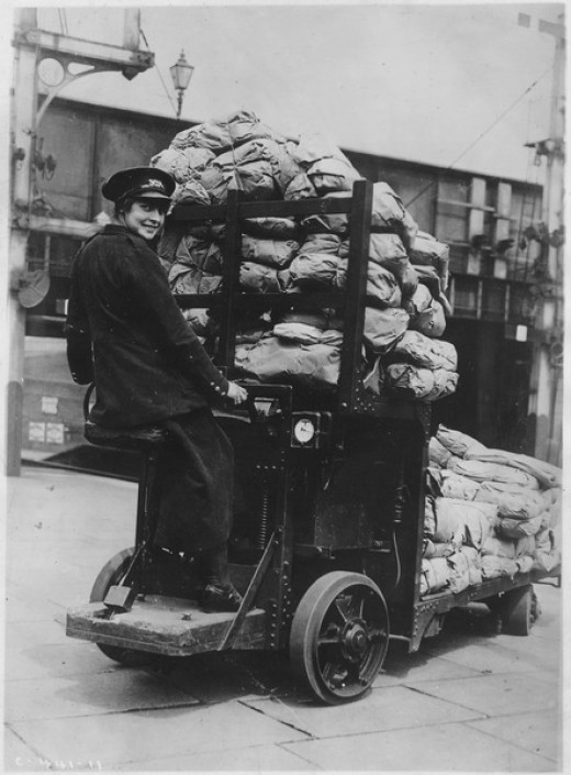 Woman driving motor mail truck 1920.
