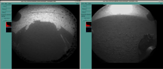 About 3-4 minutes after landing, before popping off lenscaps, Curiosity sent back these two thumbnail images showing her own shadow and wheel on Mars to confirm she's safe. (Dust kicked up from landing is on clear lens covers, which will come off.)