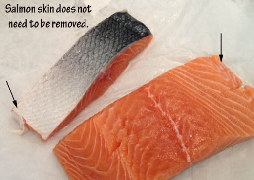 When you prepare your salmon, you'll want to remove any fatty portion of the belly that remains. That is the whitish flesh indicated by a few arrows above.