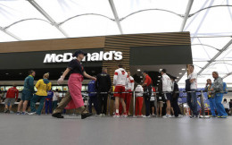 Apparently the Olympic athletes lined up day and night to raid the free McDonald's in the Olympic Village dining hall. Bonus fries for all!