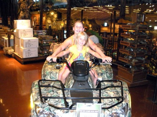 The granddaughters try on an ATV for size