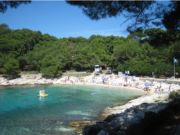 This seaside bay is in the north of Dalmatia at a town called Mali Lošinj.  It is protected from the wind and is shallow - ideal for sunbathing and relaxing!