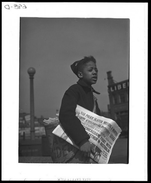 Newsboy selling the Chicago Defender, April 1942. Photo by Jack Delano.