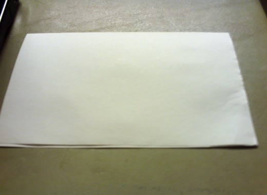 Fold the sheet of paper into a half-fold card.