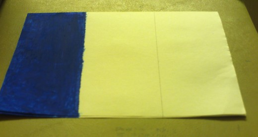 Here I have colored in the blue portion of French flag with the oil pastel of that color.