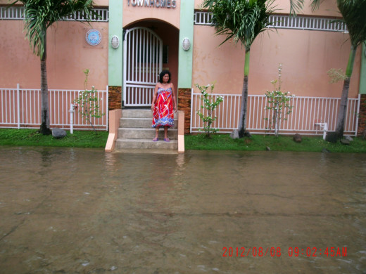 Outside the gate of my home the day after the fall. The water was up to where I am standing the night before.