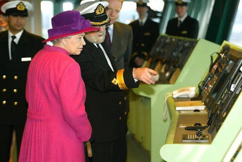 On the bridge of 2  (Photo Credit BBC) HM The  Queen and Commodore Ronald Warick