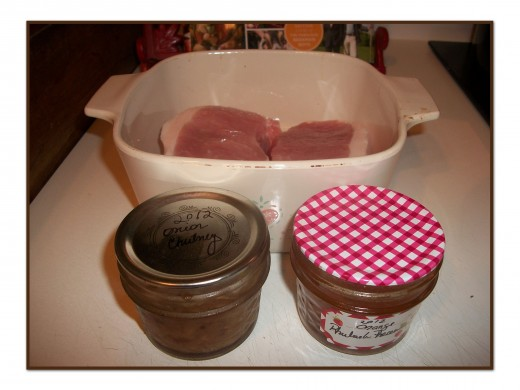 Picture: thick-cut pork chops, Vidalia onion chutney, and orange-rhubarb marmalade.