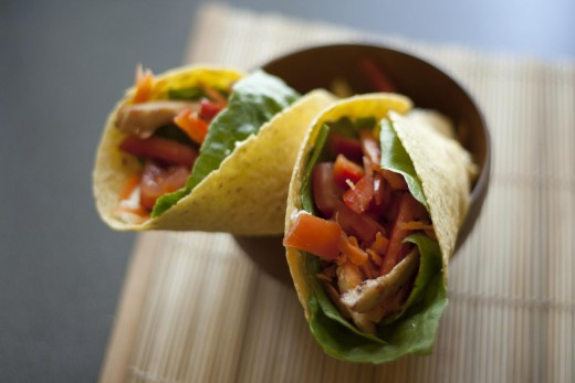 Take a familiar family favorite meal like burritos and make it healthier by adding lots of vegetables and using less fat!