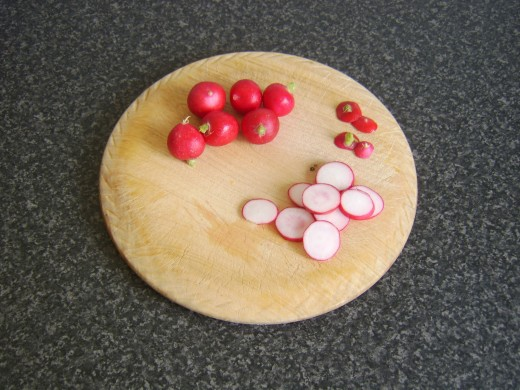 Slicing radishes for watercress salad