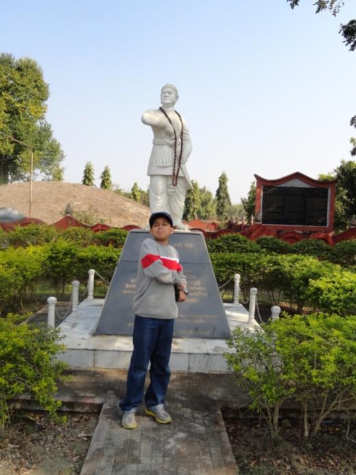 Reet in front of the Bir Lachit Borphukan Statue at Lachit Maidam