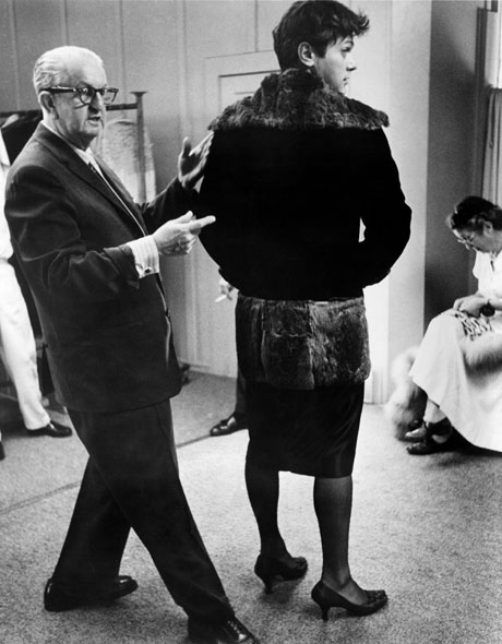 Costume designer Orry-Kelly fitting Curtis for a scene