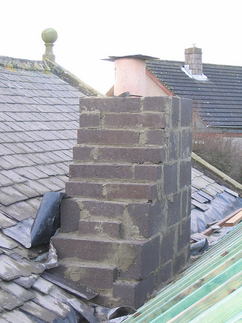Where will rainwater travel when it strikes this roof? How will the rain affect the roof next door?
