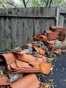 Broken roof or drainage tiles can signal water trouble. Roofs, foundations, or sewers should be checked closely if they have any broken tiles on or near them.