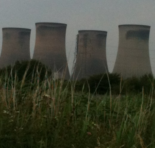 Fiddlers Ferry Power Station seen through the long grass of Sankey Valley Park, Warrington. Photo © Redberry Sky 2012.