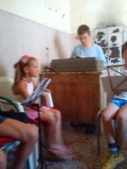 Where there is a will there is a way!  The young musicians find the corner of an attic for one of their first practice rooms.  Mateo in light blue is the leader of the group.