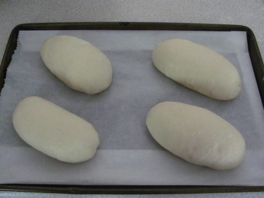 dough shaped into loaves prior to second rising and being baked