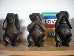 What is the meaning behind the three monkeys covering their ears, mouth and eyes?