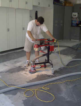 grinding the concrete surface in preparation for epoxy