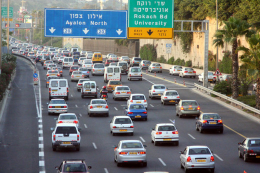 Practice safe merging! This is a photo of afternoon traffic jams near 'Halacha' Interchange at the Ayalon Highway.