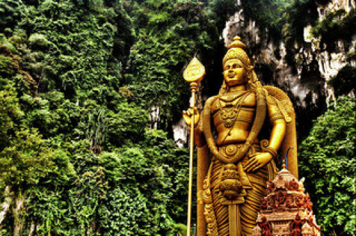 The 43m golden statue of a Hindu God is an attraction for those who cannot climb the mountainous cave temple.