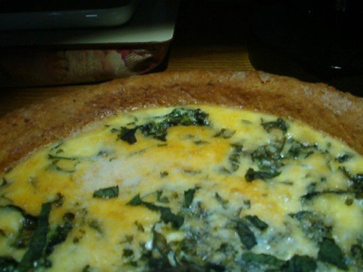 Spinach quiche with pine nut crust
