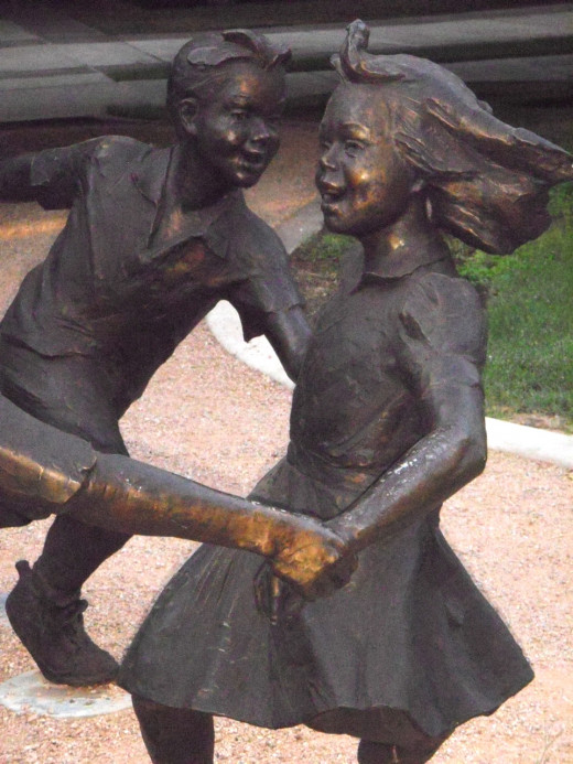 Bronze Children dancing in the park near St. Mary's Basilica.  People who lost 100, 200 or 300 pounds spoke over and over again of how grateful they are to be able to play with their children and feel free.
