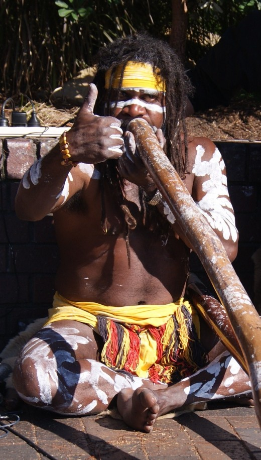 Australian Aboriginal playing the digeridoo at Circular Quay in Sydney