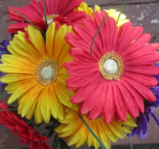 Teach colors by labeling pictures and objects, in this case yellow and red flowers.