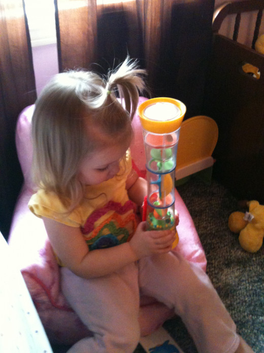 Chloe looking at her whirligig she loves this toy!!