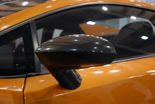 The wing mirror's shape is highlighted by bright lighting from the right. Use lighting to your advantage.