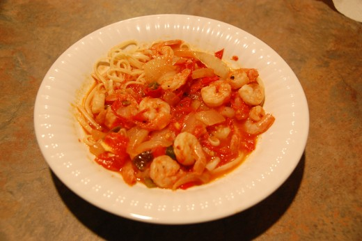 Shrimp diablo over linguine