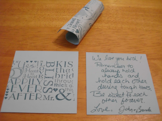 Mini love notes for guests to write on, roll up and and toss while the couple exists. Pick them up and save them in a glass container.