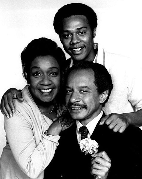 Pictured (counterclockwise): Actors Sherman Hemsley (George), Isabel Sanford (Louise) & Mike Evans (Lionel)