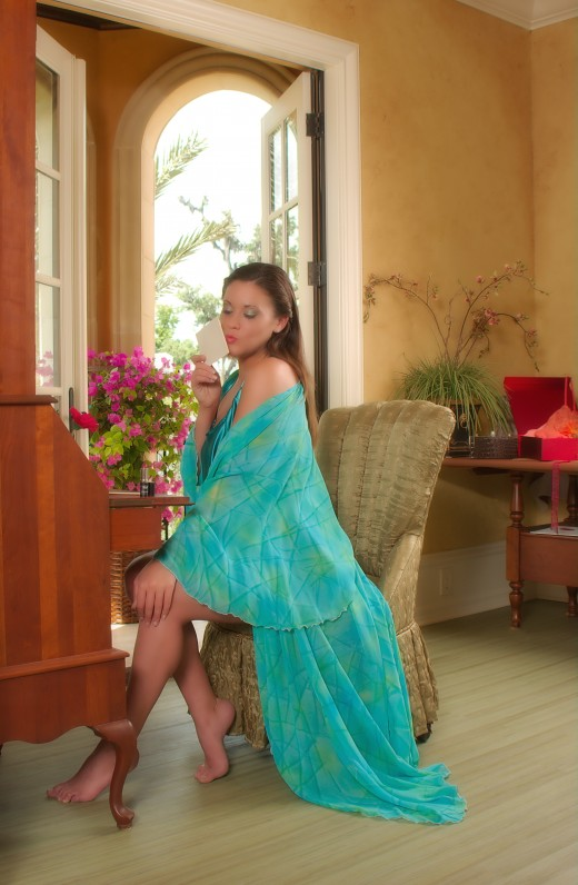 When you sell physical products, pictures of the products and their use can be a major expense, as with this silk robe from one of my own webstores.  This picture required a stylist, a makeup artists, a photographer and of course, a model.