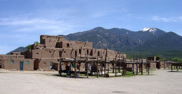Taos pueblo sits north of town with the Sangre de Christo Mountains forming an impressive eastern skyline.